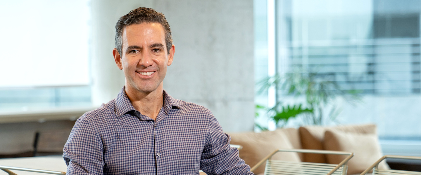 David Vélez, founder and CEO of Nubank, smiles sat at the offices.